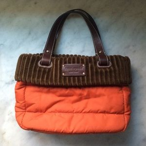 Kate Spade orange puffer bag w/brown velour trim.