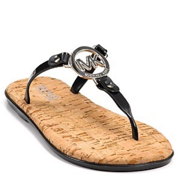 4af0965cfdf6 MK logo charm jelly crok flip flops. M 5650c7d551e9ea404f019e41. Other Shoes  you may like. Michael Kors ...
