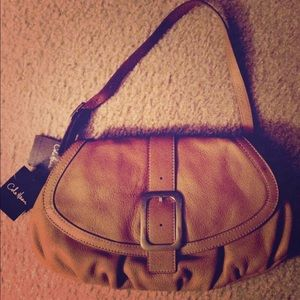 Cole Haan  tan leather shoulder bag with tags.