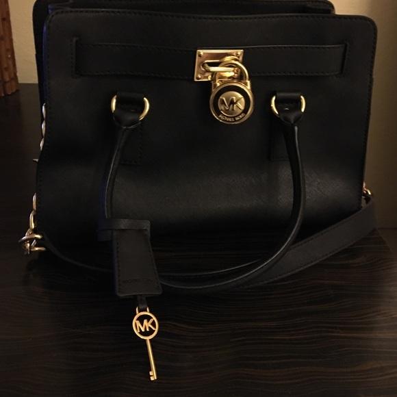 c885db13596b Michael kors purse with lock key and dust bag. M 5652abc751e9ea110602c327