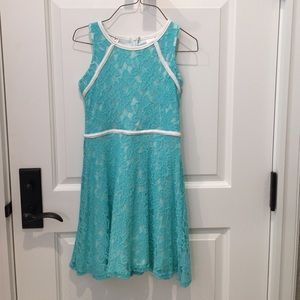 Turquoise lace dress with white leather outline