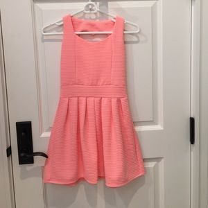 Pink dress with heart shaped hole on the back