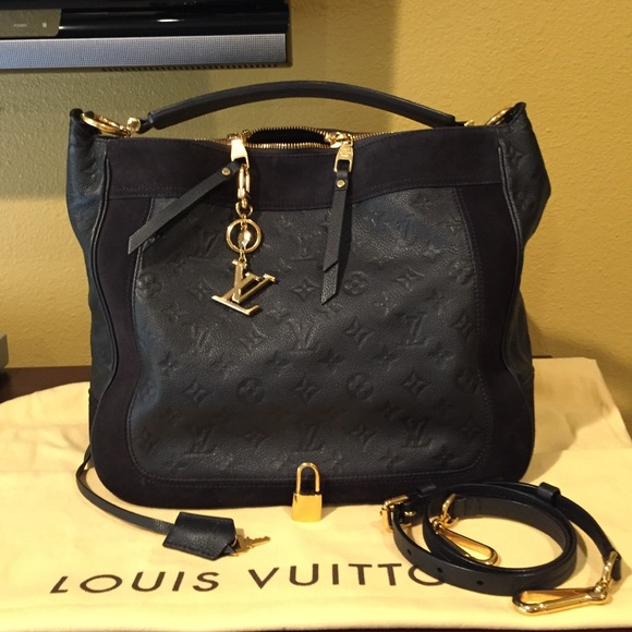 Louis Vuitton Handbags - Luis Vuitton Audacieuse MM monogram and suede 6cef4a6b9320e