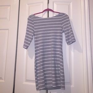 Short grey and white striped dress .