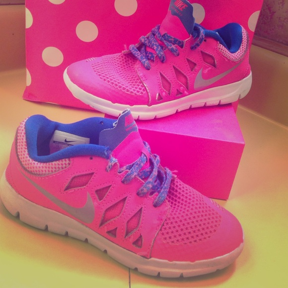 Little girl Nike free runs in Pink & Bluish/purple