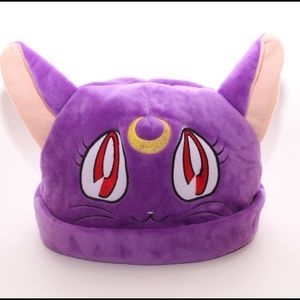 Purple cat used as dog toy