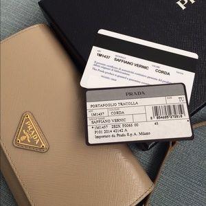 61% off Prada Handbags - PRADA beige wallet with crossbody strap ...