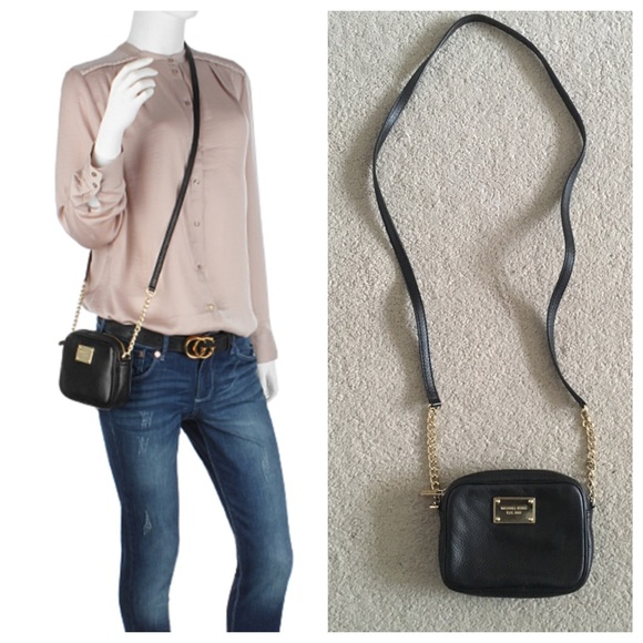 a7c3be7aefb1 Michael Kors Jet Set mini crossbody. M_565e336bd3a2a7a0af0474c9