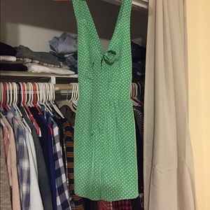 Green polka dot romper