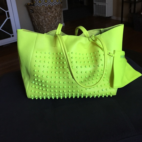 Neon green studded tote bag OS from 346k 💥buy's closet on Poshmark