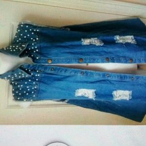 Tops - NWT, Distressed denim vest with pearl detailing.