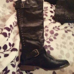 Black knee high boots with blue zipper