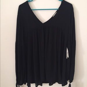 Flowy bohemian black long sleeve top!