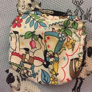 ec9d1f129d LeSportsac Bags - Lesportsac Alice in Wonderland print Cosmetic Bag