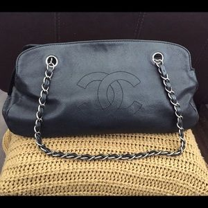 100% Chanel Black caviar bowler handbag .