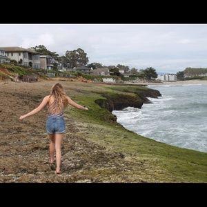 Curl Gurl Swimwear Swim - Striped swimsuit with cross cross pattern on back.