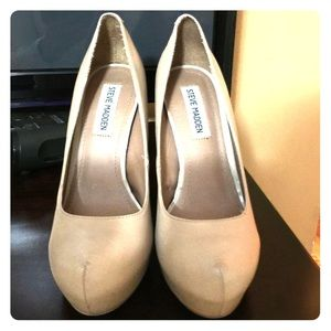 Nude color High heels  by Steve Madden .