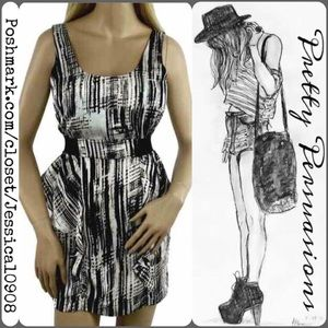 Boutique Dresses & Skirts - Black & White Ruffled Peplum Sleeveless Dress