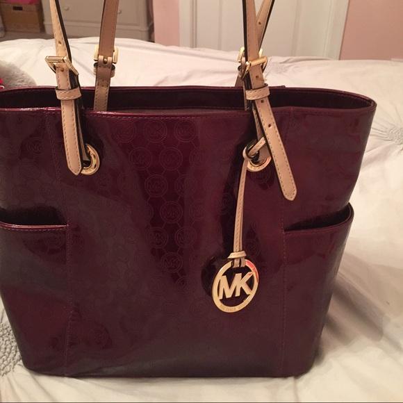 dcdf1f3295c michael kors maroon metallic bag - like new. M 566435b5b4188ebc3300f2e7