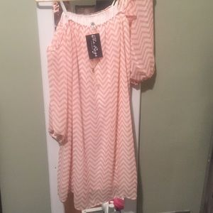 Off-the-shoulder pink and white chevron dress.