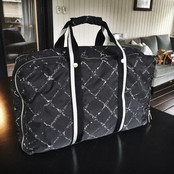 CHANEL Handbags - Vintage Chanel Black Line Nylon Travel Luggage Bag 8394b68b7962c
