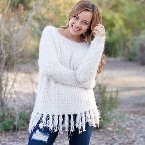 Loose knit fringe sweater