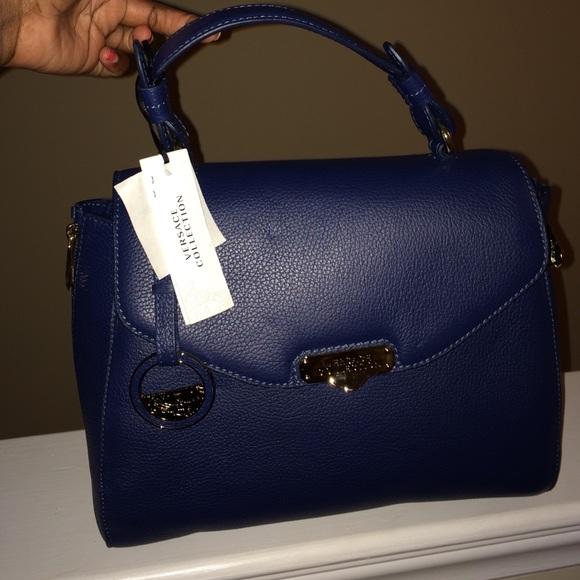 763834e2b5ad Authentic Versace purse. M 566645818e1c617ad301e0e6