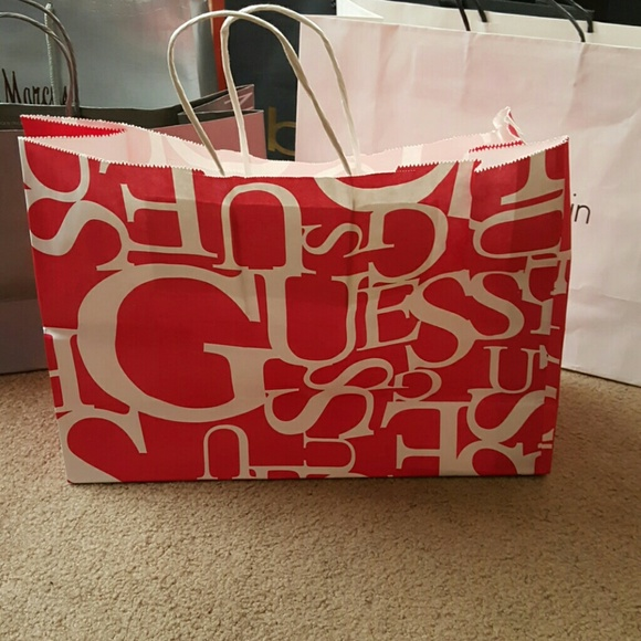 100% off Guess Handbags - Guess paper shopping bag from His ...