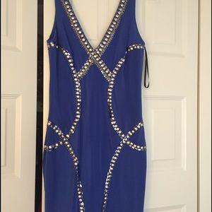 bebe Dresses & Skirts - BeBe blue tribal rings print dress