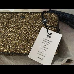 Anya Hindmarch Handbags - Anya Hindmarch gold clutch NWT