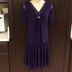 Purple midi dress with shiny bling crystals.V neck