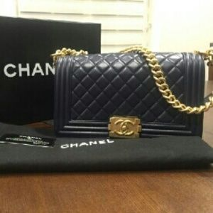 RESERVED ......Authentic Chanel Le Boy Medium Gold