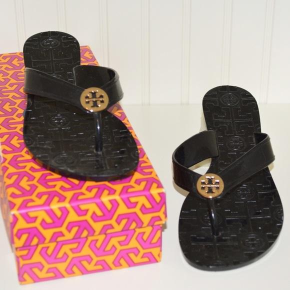 806f09dde0da Tory Burch Black Thora Patent Sandals. M 566cced66e3ec2bf8c03de1a