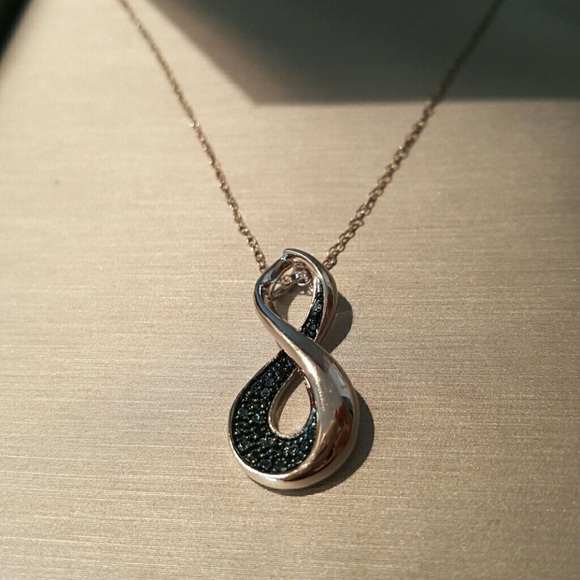 85 off zales jewelry zales figure 8 pendant from for Where is zales jewelry