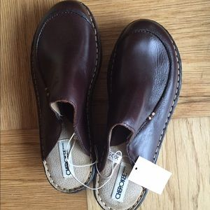Brand new brown leather clogs.