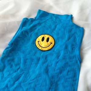 Tops - Smiley face patch on blue mock neck sleeveless top