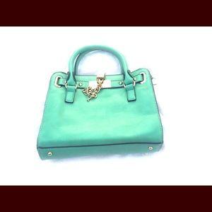 Green/teal small handbag with light gold hardware
