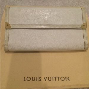 Louis Vuitton Suhali Porte Tresor leather wallet