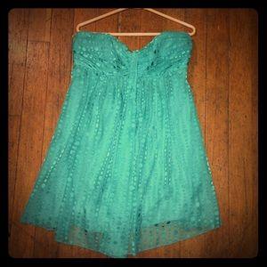 Turquoise strapless babydoll mini dress