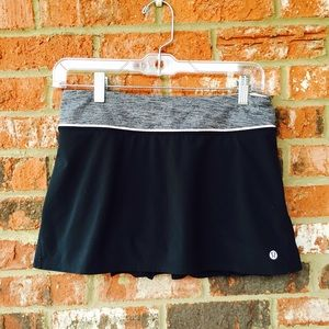 lululemon athletica Dresses & Skirts - LULULEMON black mini skirt with pink/grey trimming