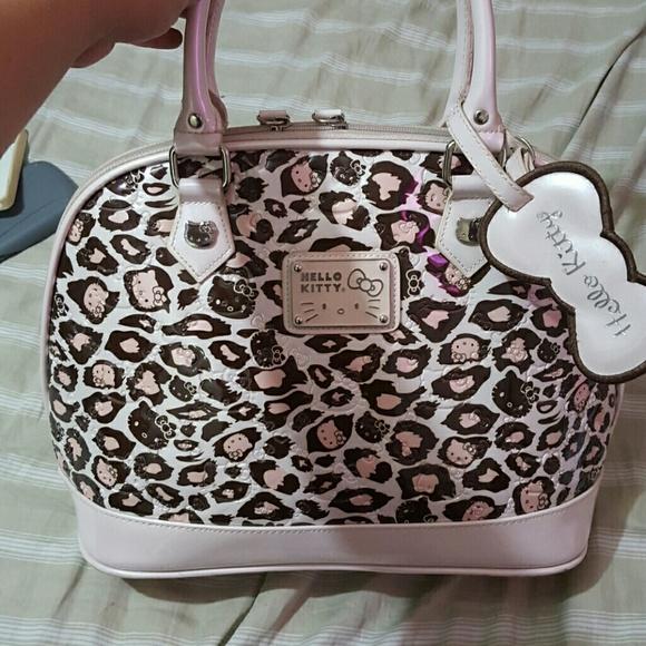 d116287ebe Hello Kitty Handbags - Hello Kitty Leopard Print Purse