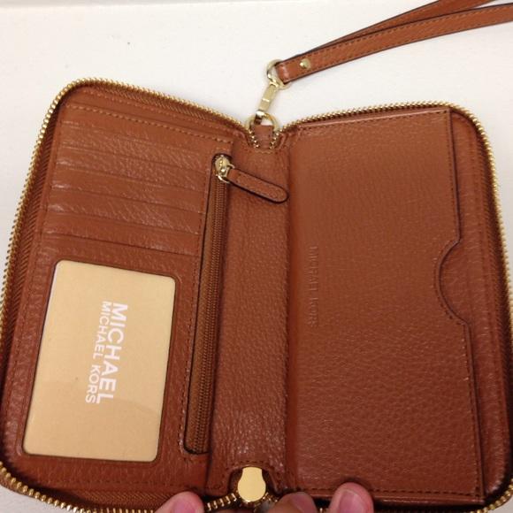1523d6b0d3dc Michael Kors Bags - SALE Michael Kors Large Fulton Smartphone Wallet .