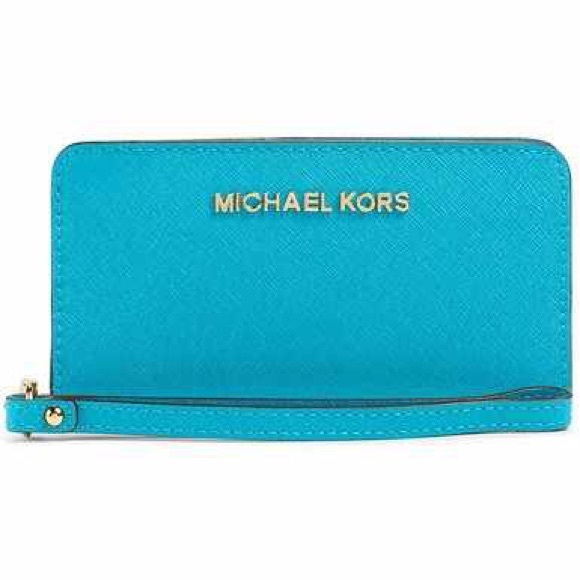 2160410e161c Jet Set Travel Saffiano Slim Tech Wristlet Wallet.  M 5676c35799086aeb560011e0. Other Bags you may like. Michael Kors ...