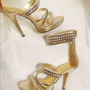 Gold studded stilettos