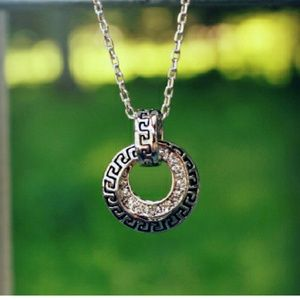 THE AURORA CO. Sacred Spiral necklace