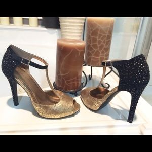 c0176c711696 BCBG Shoes - Stunning BCBG t strap heels gold and studded black