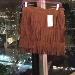 Never worn faux suede brown fringe skirt