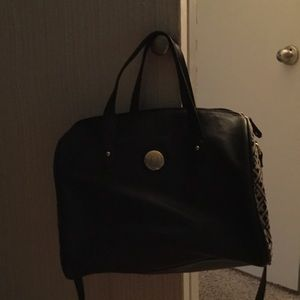 Tommy Hilfiger Handbags - Gently used....black and tan purse!!