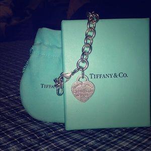 A Tiffany & Co heart charmed bracelet
