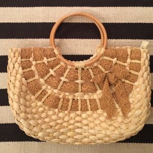 Handwoven reed bag with wooden handles. Soft feel.